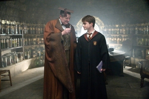JIM BROADBENT as Professor Horace Slughorn and DANIEL RADCLIFFE as Harry Potter - Harry Potter and the Half-Blood Prince